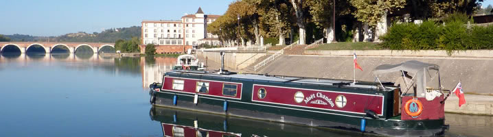 Moet Chandon coming out of the double lock onto the river Tarn in Moissac